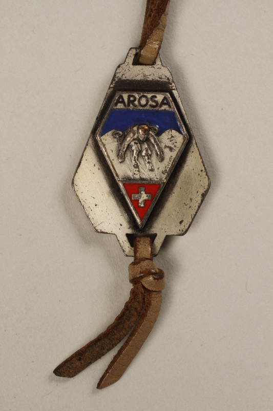 2006.19.17 back Medal with word Arosa and an image of St. Bernard owned by a German Jewish businessman in Shanghai