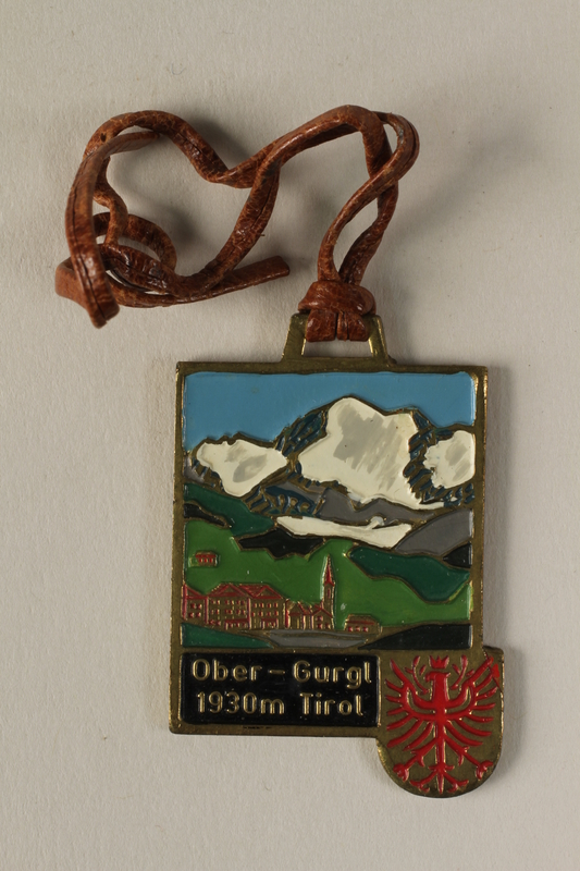 2006.19.18 front Decorative medal with a Swiss town and alps owned by a German Jewish businessman in Shanghai