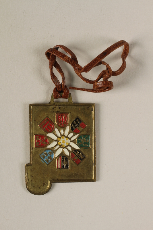 2006.19.18 back Decorative medal with a Swiss town and alps owned by a German Jewish businessman in Shanghai