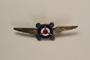 Pin of propeller wings with the letters NOBS owned by a German Jewish businessman in Shanghai