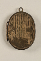 2006.19.23 front closed Oval locket with 2 photos of a young woman owned by emigres in Shanghai  Click to enlarge