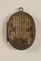 Oval locket with 2 photos of a young woman owned by emigres in Shanghai