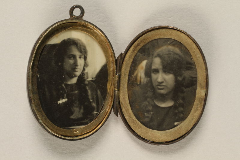 2006.19.23 front open Oval locket with 2 photos of a young woman owned by emigres in Shanghai