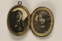 2006.19.23 front open Oval locket with 2 photos of a young woman owned by emigres in Shanghai  Click to enlarge