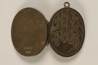 2006.19.23 back open Oval locket with 2 photos of a young woman owned by emigres in Shanghai  Click to enlarge