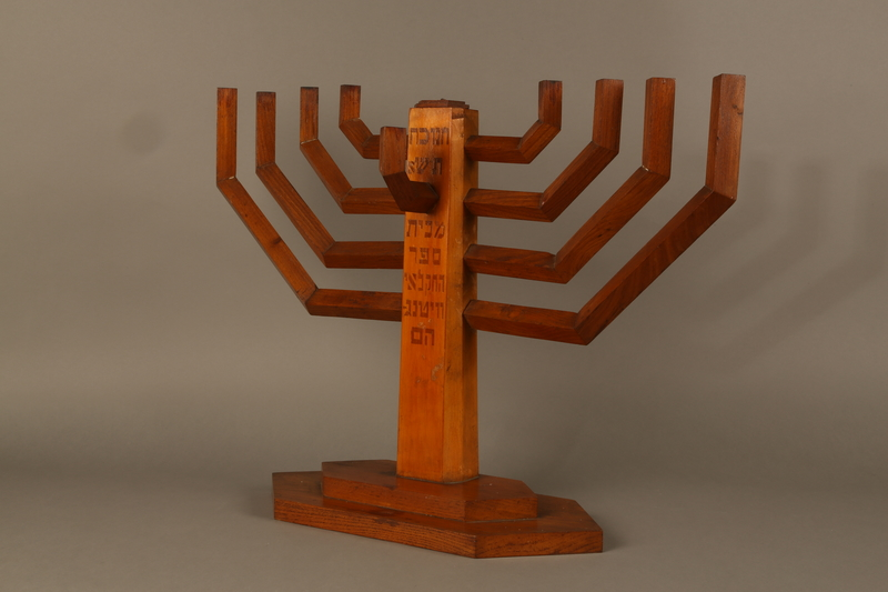 2006.69.1 3/4 view right side Handmade wooden hanukiah with Hebrew inscription made by Kindertransport refugees