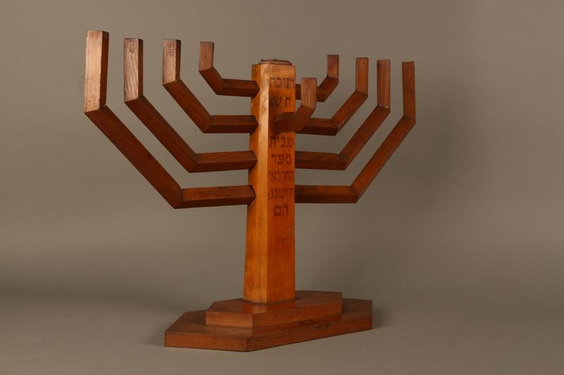 2006.69.1 3/4 view left side Handmade wooden hanukiah with Hebrew inscription made by Kindertransport refugees