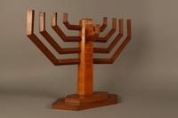 2006.69.1 3/4 view left side Handmade wooden hanukiah with Hebrew inscription made by Kindertransport refugees  Click to enlarge