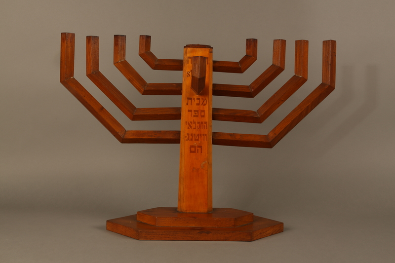 2006.69.1 front Handmade wooden hanukiah with Hebrew inscription made by Kindertransport refugees