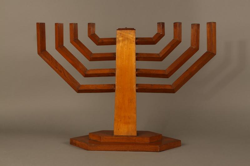 2006.69.1 back Handmade wooden hanukiah with Hebrew inscription made by Kindertransport refugees