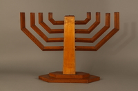 2006.69.1 back Handmade wooden hanukiah with Hebrew inscription made by Kindertransport refugees  Click to enlarge
