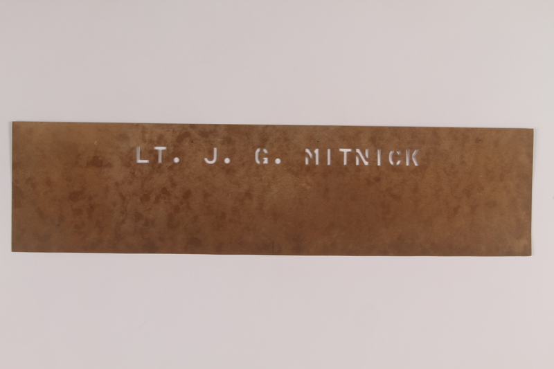 2006.11.38 front Lt. J. George Mitnick stencil used to label his US Army equipment