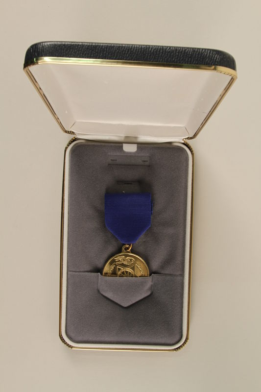 2006.11.40_a-b front Republican Senatorial Medal of Freedom and presentation case awarded to J. George Mitnick
