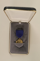 2006.11.40_a-b front Republican Senatorial Medal of Freedom and presentation case awarded to J. George Mitnick  Click to enlarge