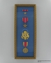 Framed set of military medals, ribbons, and insignia awarded to US Army Captain J.G. Mitnick
