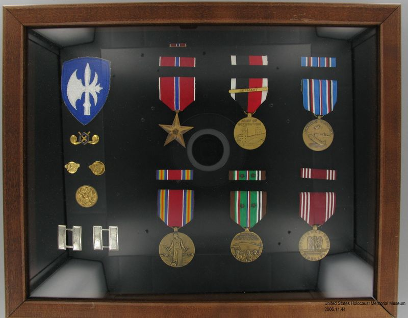 2006.11.44, Framed shadow box of military medals, ribbons, and insignia, J. George Mitnick Collection Framed shadow box of military medals and ribbons awarded to a US Army Captain