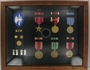 Framed shadow box of military medals and ribbons awarded to a US Army Captain