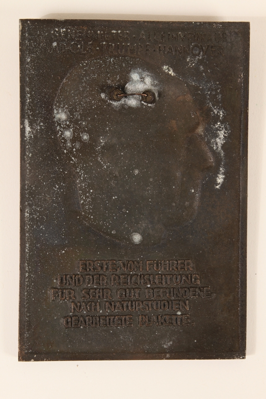2006.258.11 back Adolf Hitler bas-relief commemorative plaque aquired by a US soldier