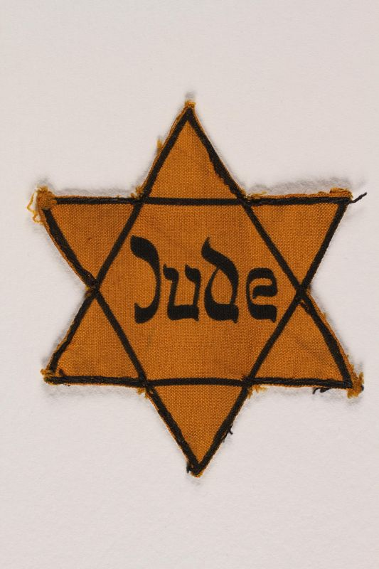2002.131.2 front Star of David badge with Jude printed in the center