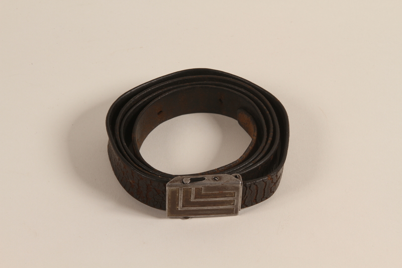 2006.451.1 front Leather belt with metal buckle worn by a concentration camp inmate
