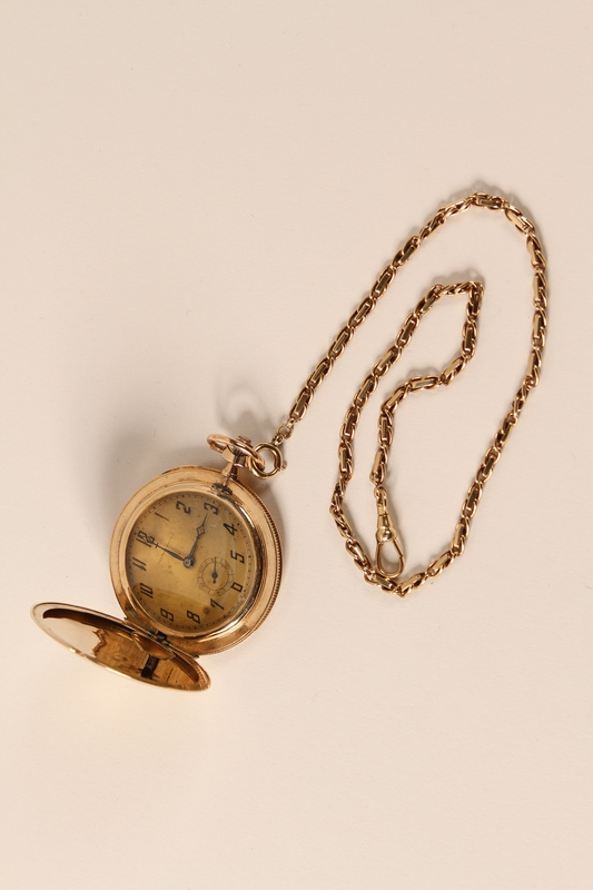 2006.450.1 open Pocket watch with chain traded for food by a concentration camp inmate and recovered postwar