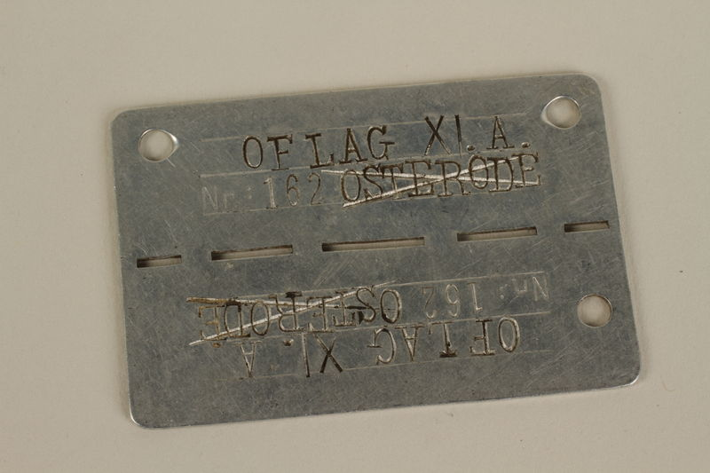 2007.34.2 front German prisoner of war identification tag worn by a Jewish soldier in the Polish Army