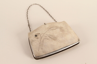 2007.42.1 front Silver purse with an engraved butterfly and a chain strap used by a hidden child  Click to enlarge
