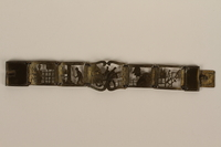 2007.45.3 front Brass bracelet with cutout designs of scenes of daily life made in Łódź Ghetto  Click to enlarge