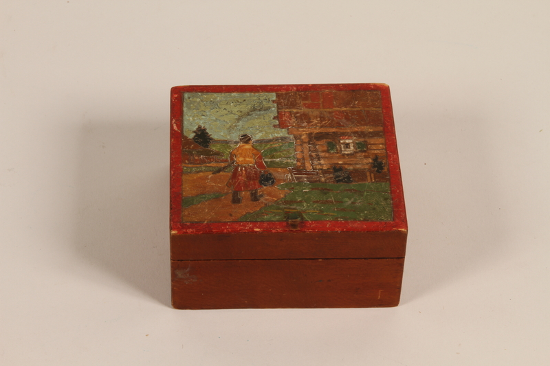 2007.101.5 closed Wooden box with a painted Lithuanian folk scene with man given to a German Jewish refugee