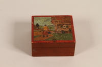 2007.101.5 closed Wooden box with a painted Lithuanian folk scene with man given to a German Jewish refugee  Click to enlarge