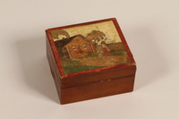 2007.101.6 closed Wooden box painted with a woman in Lithuanian folk dress given to a German Jewish refugee  Click to enlarge