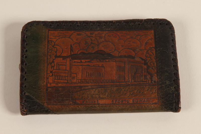 2007.101.7 back Monogrammed black and tan laced leather wallet used by a German Jewish refugee