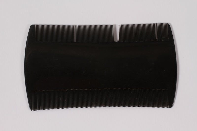 2007.101.12 front Black plastic dust comb owned by a German Jewish refugee
