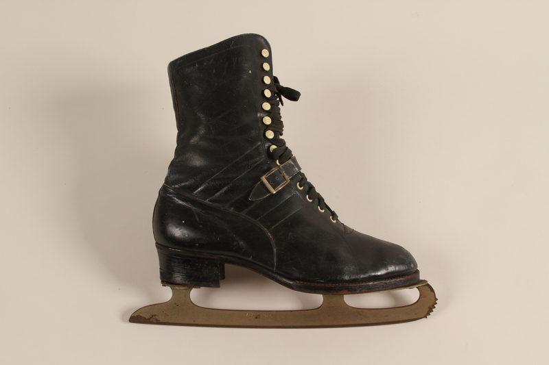 2007.101.13 front Pair of black leather lace-up ice skates owned by a German Jewish refugee