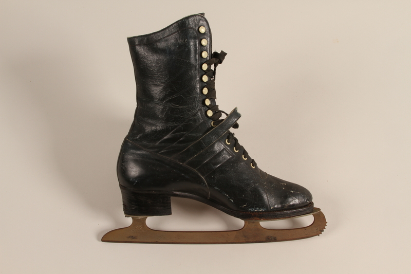 2007.101.13 b front Pair of black leather lace-up ice skates owned by a German Jewish refugee