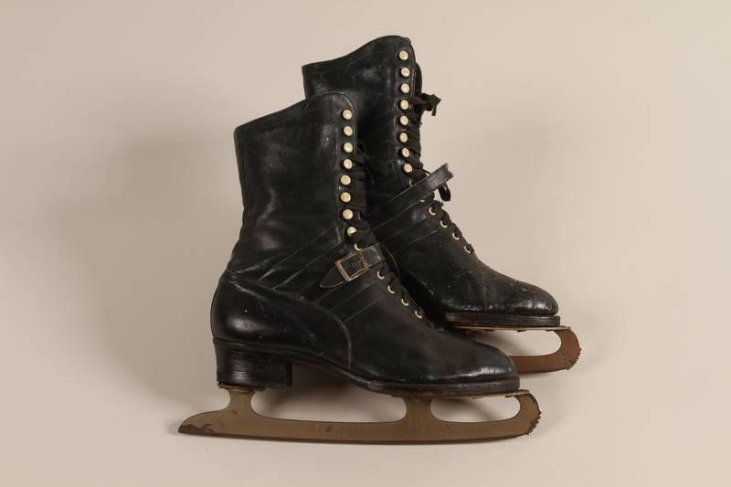 2007.101.13 a-b front Pair of black leather lace-up ice skates owned by a German Jewish refugee