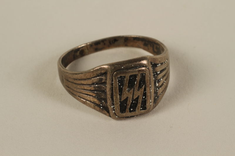 2007.126.2 front SS insignia ring taken from a concentration camp guard by inmates to give to a US soldier