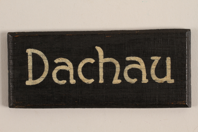 2007.234.1 front Sign for Dachau concentration camp acquired by a US soldier