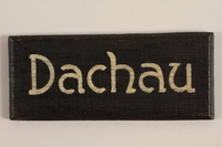 2007.234.1 front Sign for Dachau concentration camp acquired by a US soldier  Click to enlarge