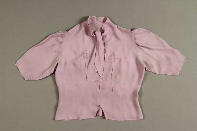 2007.175.2 front Lavender blouse with tie worn during a young woman's escape from the Warsaw ghetto