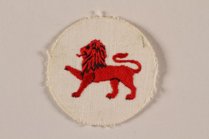 2007.205.7 front Boy Scout badge with an embroidered red lion worn by a Jewish refugee in Shanghai