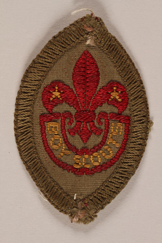 2007.205.8 front World Scout badge with a fleur-de-lis and star worn by a Jewish refugee in Shanghai