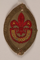 2007.205.8 front World Scout badge with a fleur-de-lis and star worn by a Jewish refugee in Shanghai  Click to enlarge