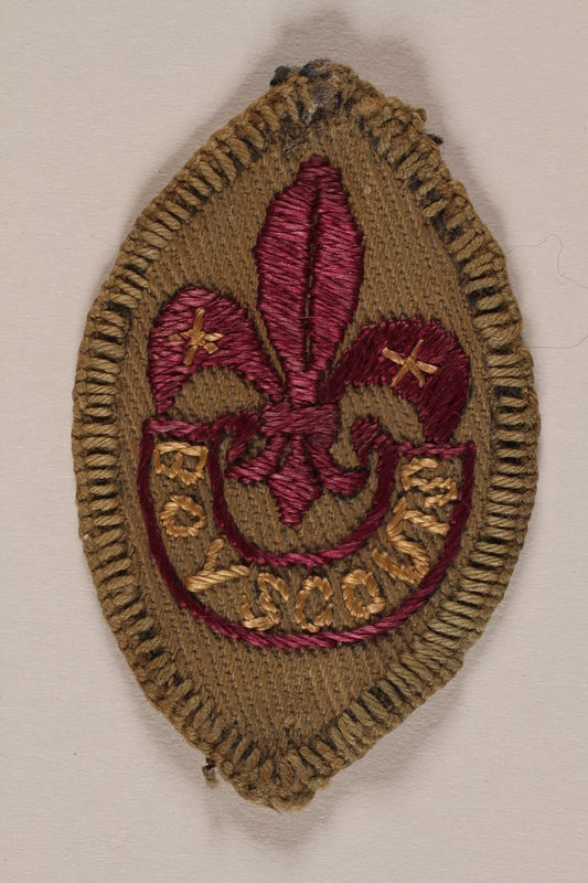 2007.205.9 front World Scout badge with a fleur-de-lis and star worn by a Jewish refugee in Shanghai
