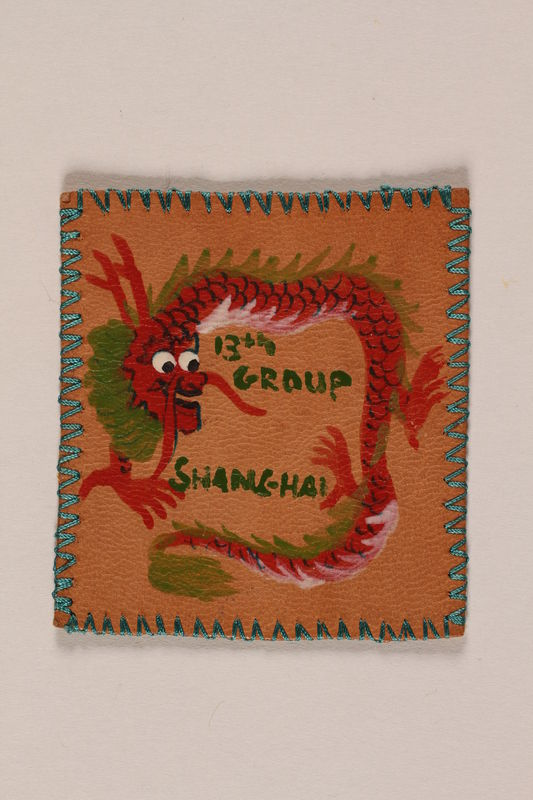 2007.205.10 front Leather Boy Scout badge with a red dragon worn by a Jewish refugee in Shanghai