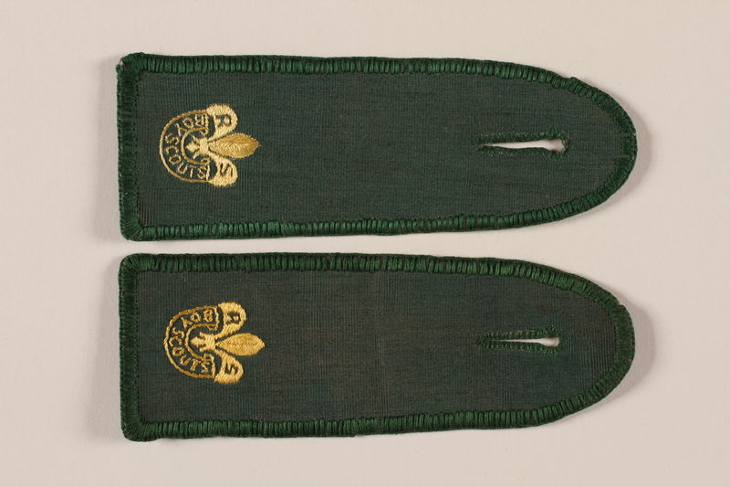 2007.205.11_a-b front Rover Boy Scout set of green epaulets with fleur-de-lis worn by a Jewish refugee