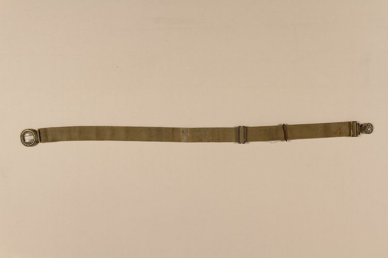 2007.205.15 front Green canvas belt for a Boy Scout uniform used by a Jewish refugee in Shanghai