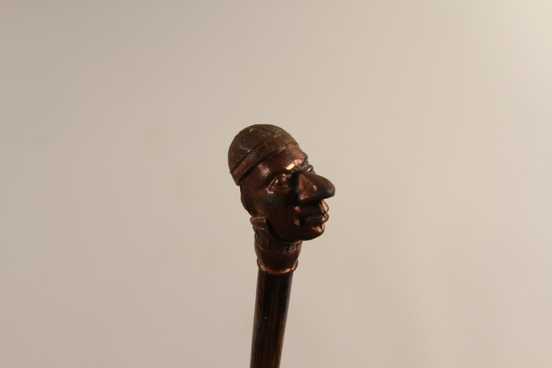 2001.324.1 top Walking stick with a knob shaped as the head of a Jewish man in a yarmulke