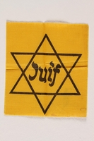 2001.233.2 front Yellow cloth Star of David badge with Juif printed in center  Click to enlarge