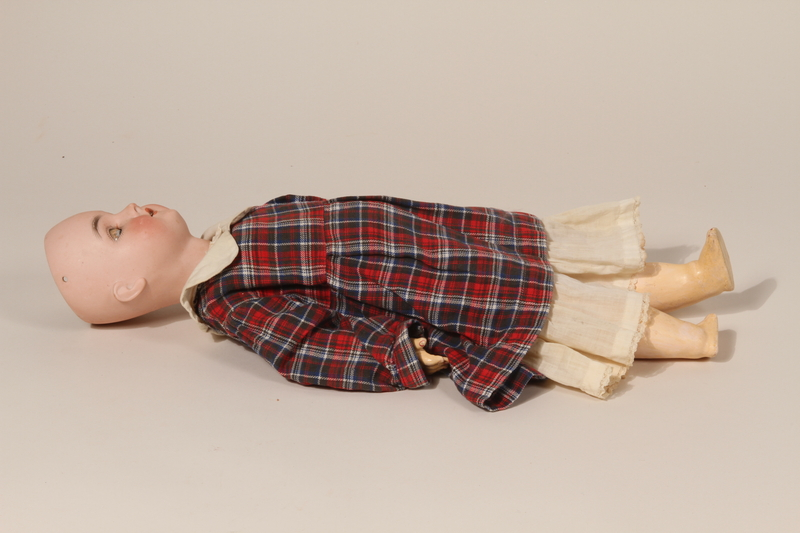 2002.57.1 front Porcelain doll with dress